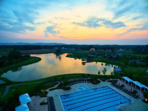 Willowsford pool and lake sunset 35